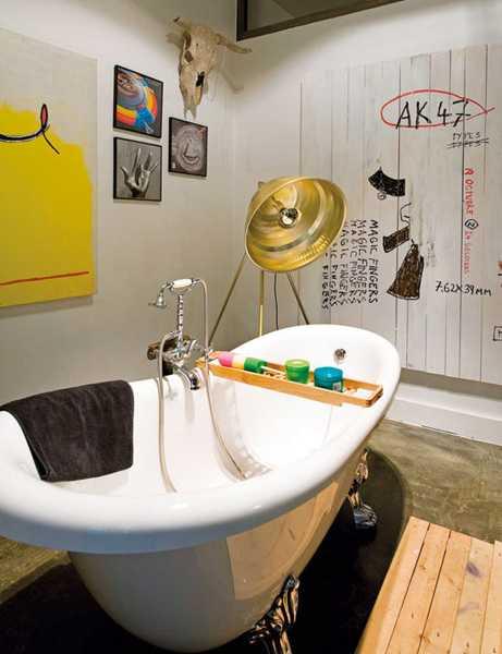 small bathroom decor, claw foot bathtub and yellow wall art