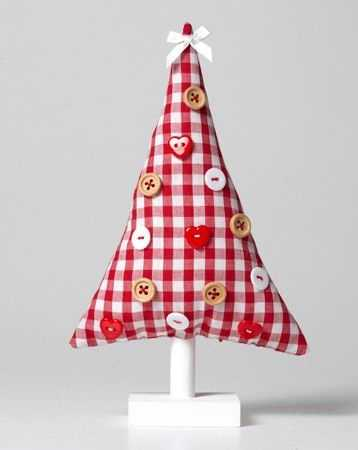 white and red fabric christmas tree decorated with buttons