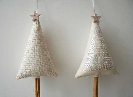 white fabric christmas trees with stars