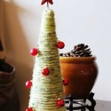 yarn christmas tree with red ornaments