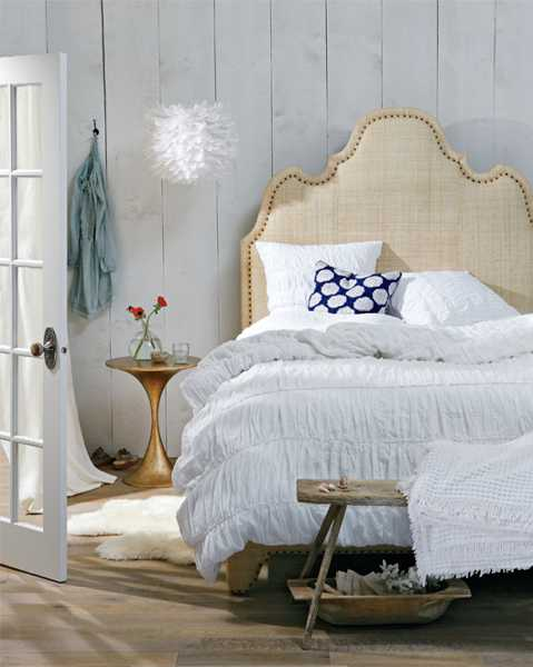 tall bed headboard and white bedding