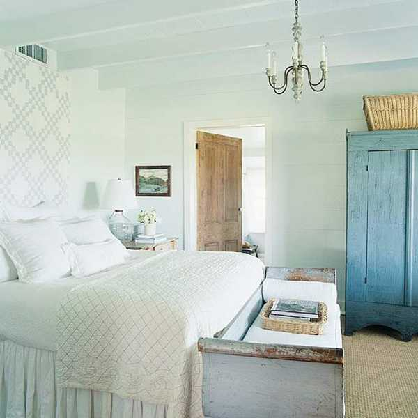 white bedding and blue bedroom furniture in country home style