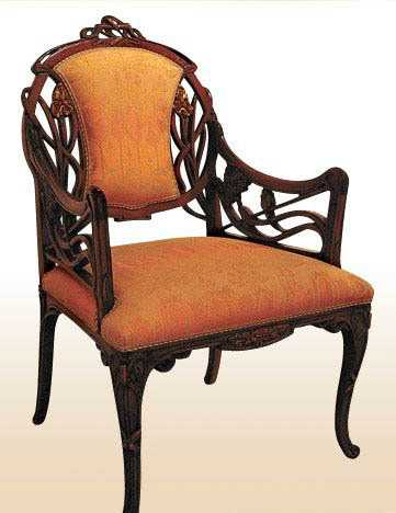 chair design with carved wood details and orabge upholstery in modern style