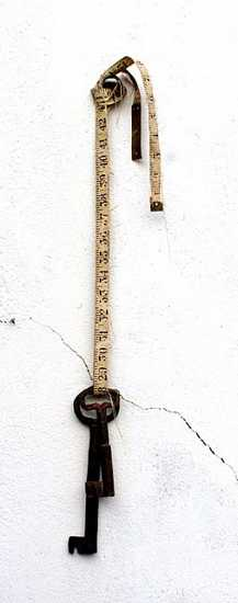 wall decoration in vintage style, old key and tape measure