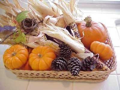 mini pumpkins, corn heads and pine cones for thanskgiving table centerpiece