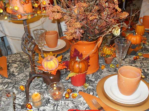 fall flower arrangement and orange tableware