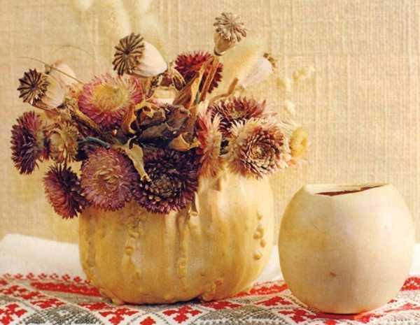 pumpkin vase with fall flower arrangement for thanskgiving table decoration
