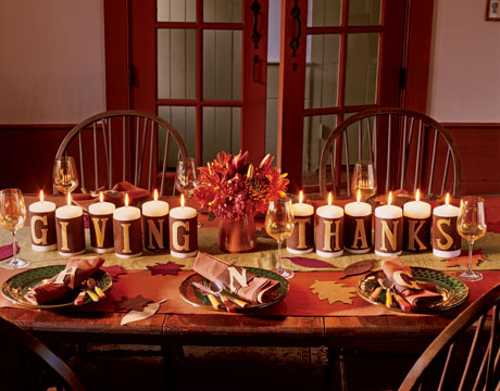 candles centerpieces with letters and fall leaves table decorations