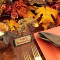 small candles centerpieces and green napkins for thanksgiving party table decor