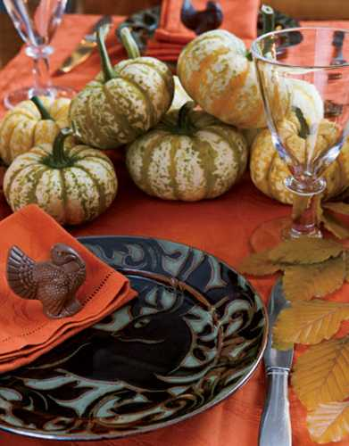 individual table centerpieces with chocolate turkey and orange napkins