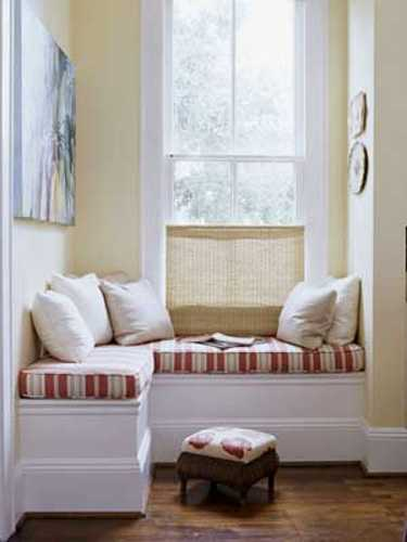 white bench with red and white cushions