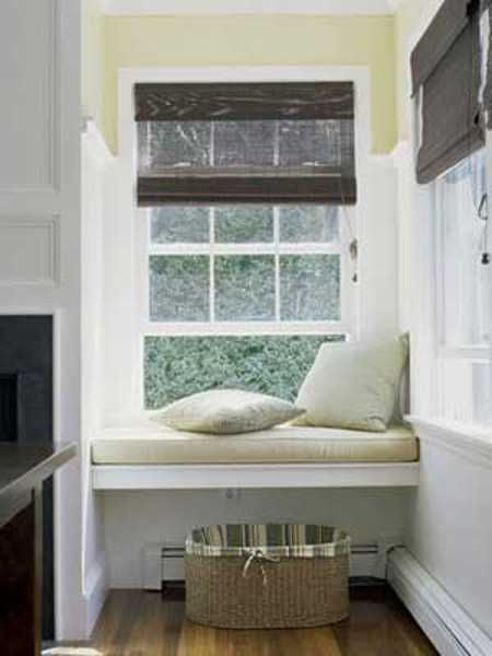 white bench with white cushions and storage