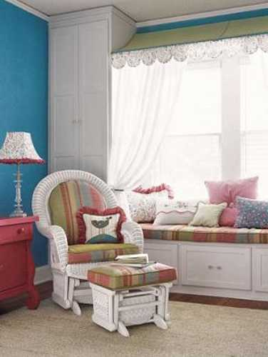 white bench with storage, white curtains and colorful cushions