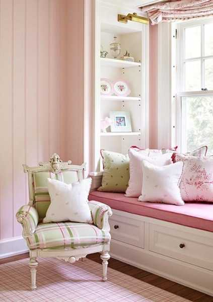 white bench with storage and pink cushion