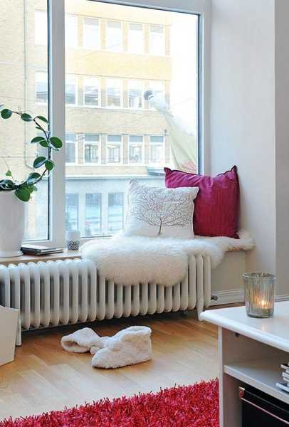 white bench with cushions in qhite and pink colors