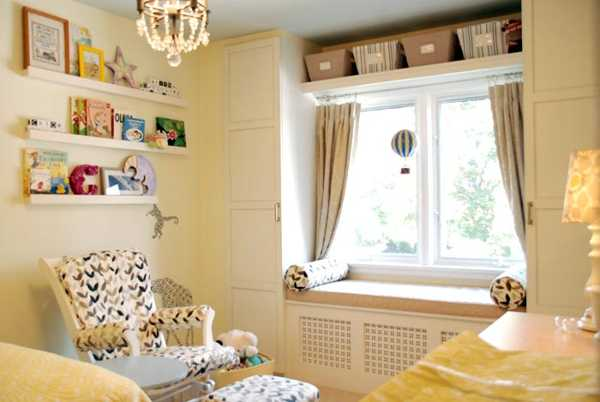 white bench wigh cushions and curtains