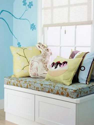 white bench with colorful cushions