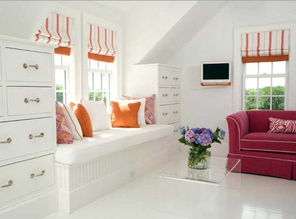 white bench with cushions and curtains in orange color