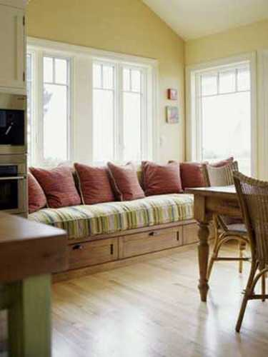 dining room decorating with large window bench and cushions
