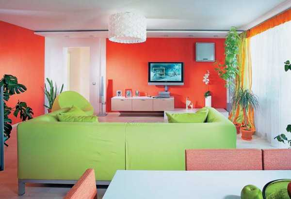 red wall and green living room furniture