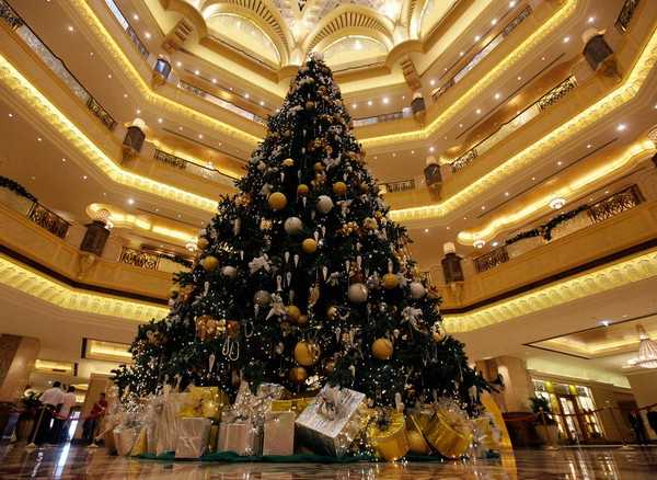 black christmas tree with decorations in golden colors