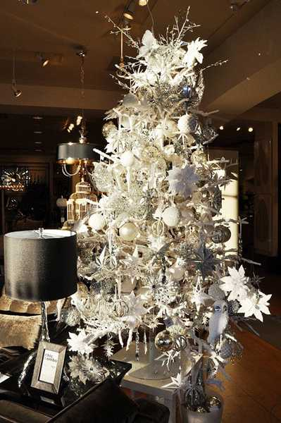 white christmas tree and black decor items
