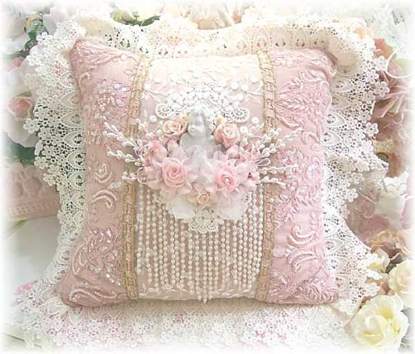 decorative pillows with lace and floral designs