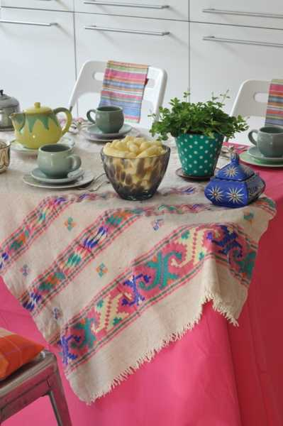 handmade embroidery on tablecloth for ethnic interior decorating