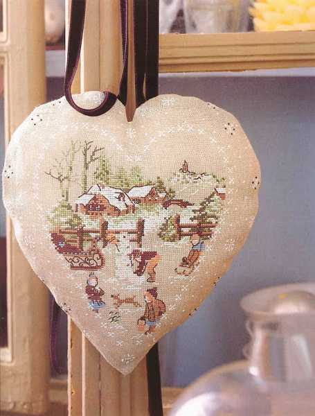 hearts decorations with christmas embroidery in vintage style