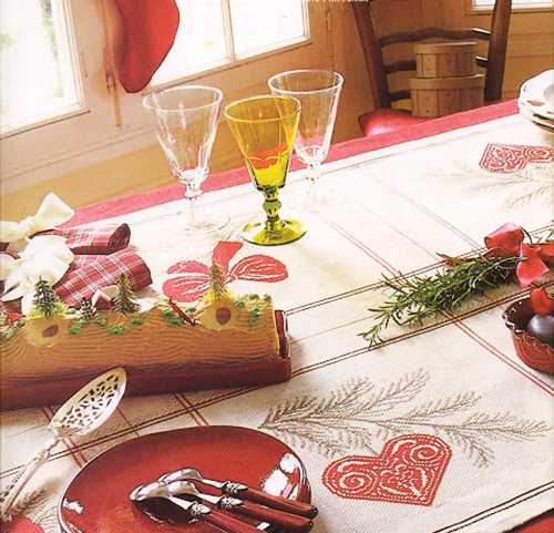 christmas table decoration with embroidered tablecloth in vintage style