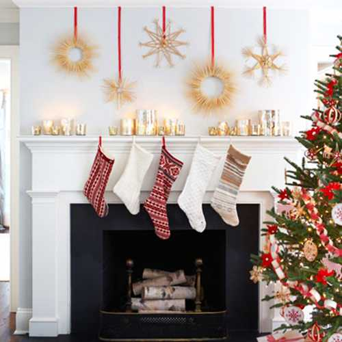 paper christmas decorations and stockings for fireplace decorating