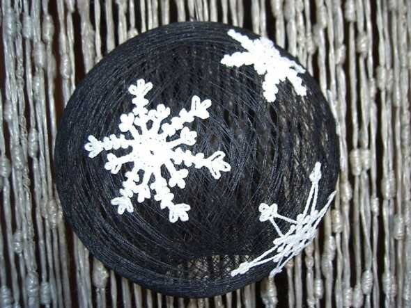 black christmas ball with white snowflakes