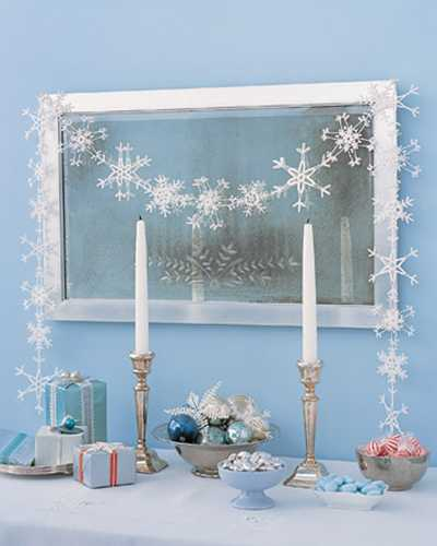 mirror decorated with snowflake garland