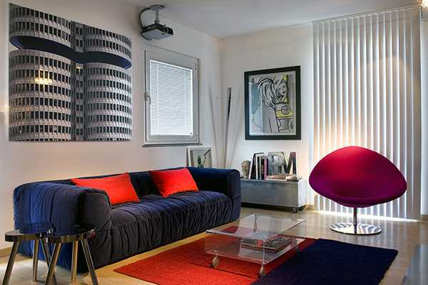 living room design with artworks and red accents