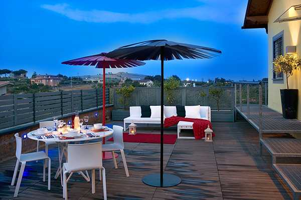 white patio furniture and red decorative accessories