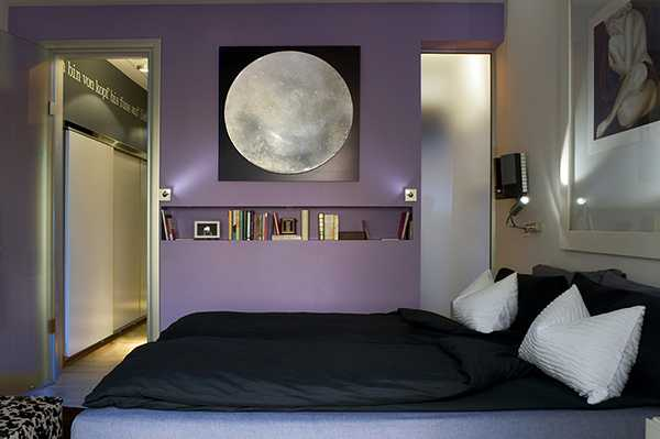 black and white bedroom decor and purple wall paint color