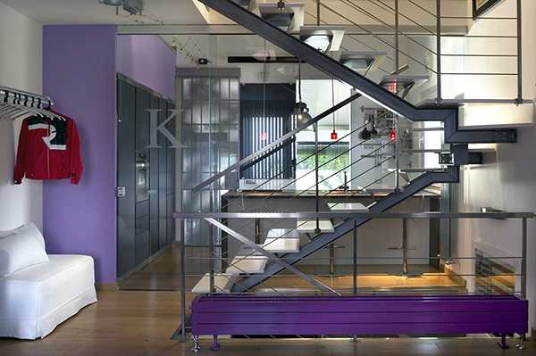 steel staircase design and purple wall paint color