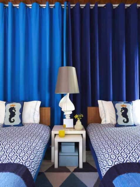 blue curtain on wall in bedroom