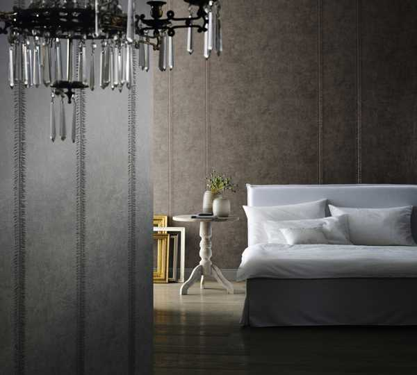 bedroom decor with gray wallpaper pattern and glass chandelier