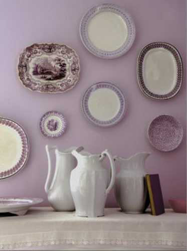 purple wall paint and white china for interior decorating
