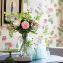 floral wallpaper and antique glass vases with flowers
