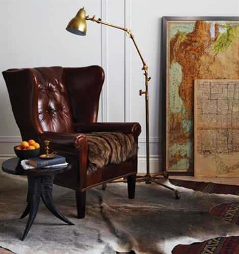 vintage furniture chair and side table, antique maps and floor lamp
