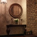 round wall mirror in wooden frame and antique console table