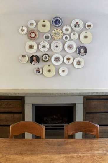antique decorative plates on wall and vintage chairs for boho chic home decorating