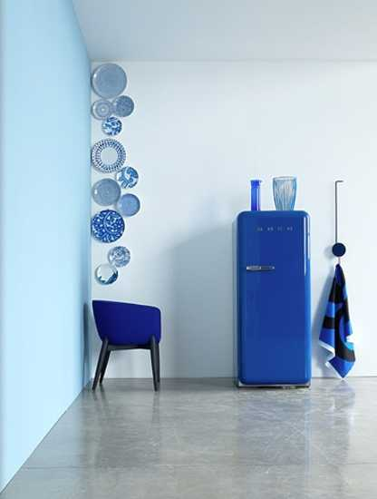 retro fridge, vintage chair and decorative plates in blue color