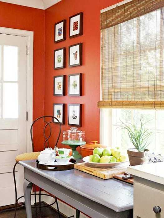 orange wall paint and bamboo roll up blinds