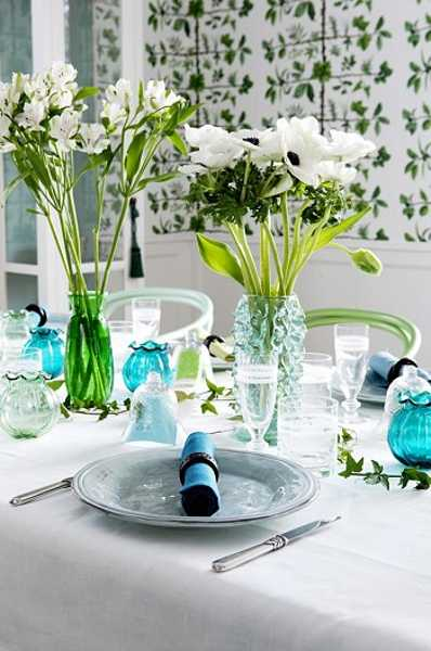 turquoise vases and napkins with white tablecloth