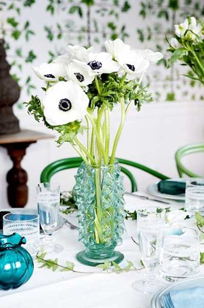 turquoise vase with white flowers for table decoration