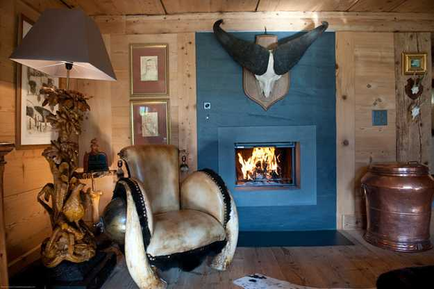 blue fireplace and unique lamp and chair decorated with fur