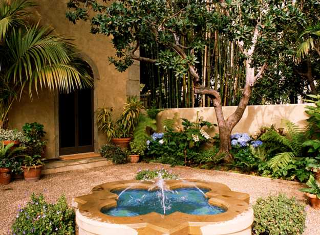 backyard design with fountain in mediterranean style
